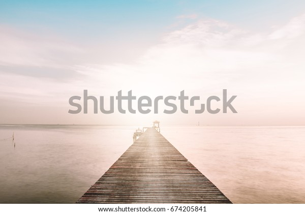 Vacation and Holiday concept - Wooden pier between sunset in Samut Prakan, Thailand,Summer, Travel