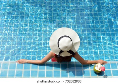 Vacation holidays background wallpaper .Close up view of an attractive young woman relaxing on a spa's swimming pool. Travel, happiness emotion, summer holiday concept .