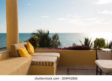 vacation, home and travel concept - sea view from balcony of home or hotel room