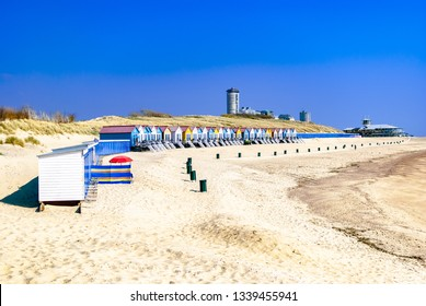 Vacation homes standing along the coastline. with a looming modern city at the background. Summer concept. Vacation rentals. Retreat. Spring. Nature therapy. Vlissingen, the Netherlands. Northern sea.