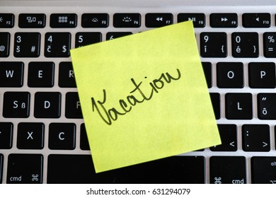 Vacation needed. Holiday office message on laptop. Out of office.