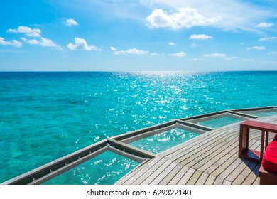 Vacation net seat in tropical Maldives island and beauty of the sea with the coral reefs