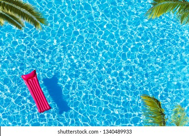 Vacation pool with matrass surface and palm trees