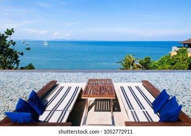 Vacation Relaxation sunken lounge seat in infinity edge pool with ocean andaman sea view, Phuket Thailand with blue sky