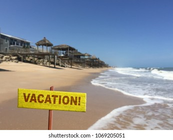 Vacation sign on beach background