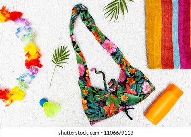 Vacation style postcard concept with swimsuit and summer beach accessories