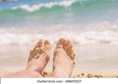 Vacation Summer Holiday,man feet on the sand beach