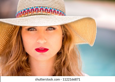 Vacation time in Los ANgeles Beautiful golden toned woman looking serenely at camera