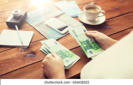 vacation, tourism, travel, finances and people concept - close up of traveler hands counting euro cash money