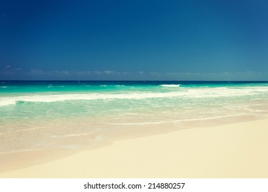 vacation, travel and background concept - blue sea or ocean, white sand and sky