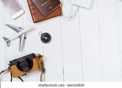 Vacation travel equipment on white wooden copy space