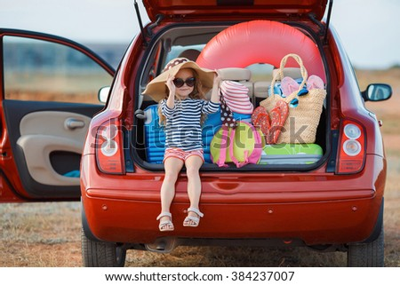 Vacation, Travel - family ready for the travel for summer vacation. suitcases and car with sea on background. girl with map in hands planning road trip. travel concept. traveler.