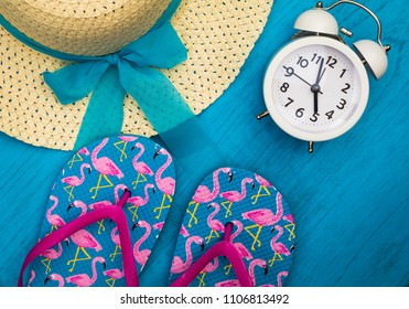 Vacation and Travel still life concept in bright colors and blue board, flat lay in vintage tones
