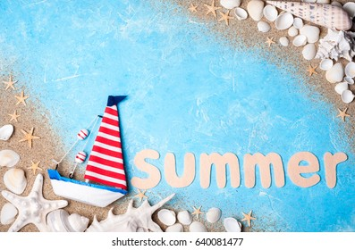 Vacation and travel. Summer background. Sea card with ship, sand, shells and starfish on blue background top view. Copy space