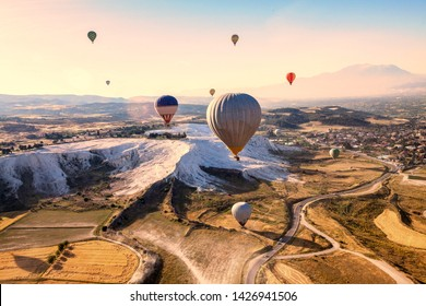 Vacation in Turkey showing hot air balloon flying across Pamukkale in Hierapolis
