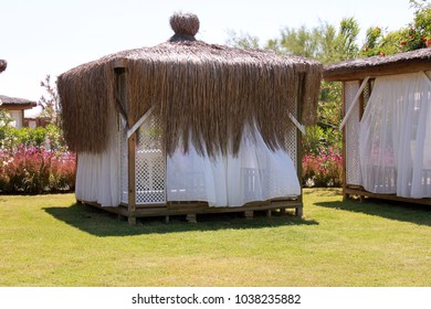 Vacation, weekend, travel, summer concept. Bungalow on the beach.