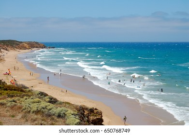 Vacationers enjoy the waves on Bells Beach at Torquay on the Great Ocean Road, Victoria, Australia, 14 January 2009