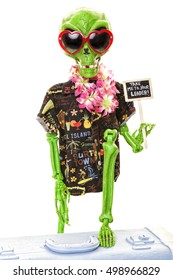 Vacationing alien trying to hitchhike.  Shot on white background.