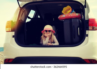 Vacations And Tourism Concept, Little girl in the rent car