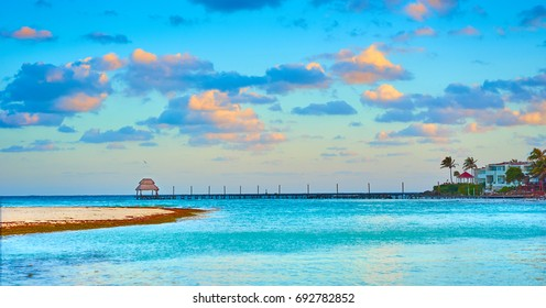 Vacations And Tourism Concept - Tropic Paradise in the early morning hours.  Jetty on Isla 026f651cd4a1b