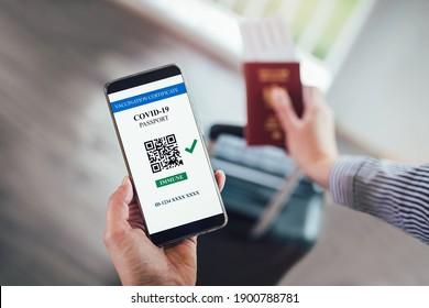 Vaccination, disease immunity passport, health and surveillance concepts. Smartphone displaying a valid digital vaccination certificate for COVID-19