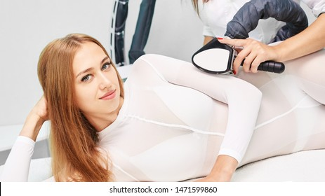 Vaccuum massage procedure. Anti cellulite lpg treatment. Cosmetology slimming. Medical device. Woman and doctor in salon. Lipo contouring.