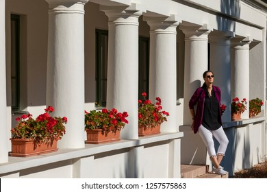 Vacratot Hungary Oct 25 2018: A lady posing at a country cottage while sunbathing.