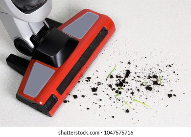 Vacuum cleaner cleans the ground and dirt from the floor