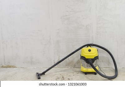 vacuum cleaner construction on the background of concrete walls and floors