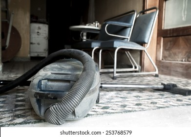 Vacuum cleaner in an old dusty house