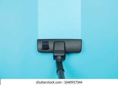 Vacuum cleaner on the blue floor background. showing house cleaning concept