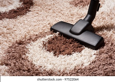 vacuum cleaner on brown carpet