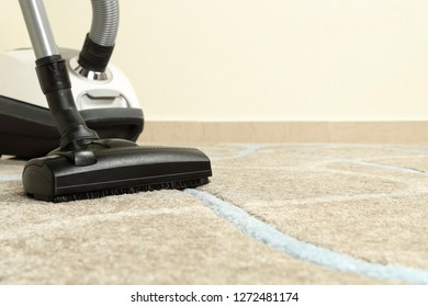 vacuum cleaner on carpet with copy space