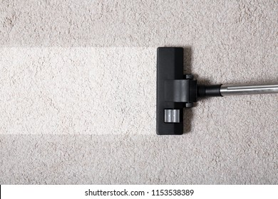 Vacuum cleaner on carpet indoors, closeup. Cleaning service