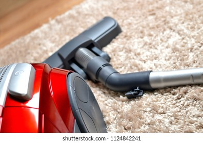 Vacuum cleaner on hairy carpet - close-up of head noozle and modern hoover