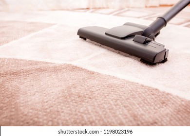 Vacuum cleaner in the room on the carpet, cleanliness in the house, cleaning