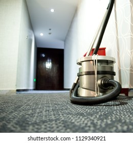 vacuum cleaner stands in the hotel corridor.