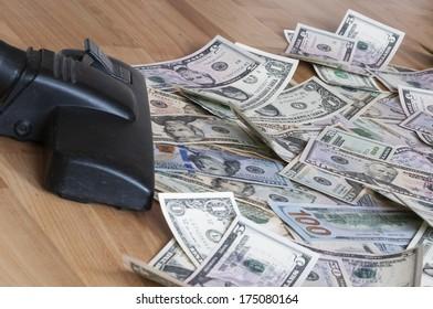 Vacuum cleaner sucks on U.S. dollars.