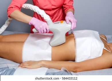 Vacuum massage of the abdomen of a young girl. Instrumental cosmetology. Spa Studio. Rejuvenation and skin tightening. Postnatal stretch marks.