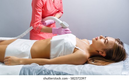 Vacuum massage the body of a young girl. Hardware cosmetology. Spa Studio. Rejuvenation and skin tightening.