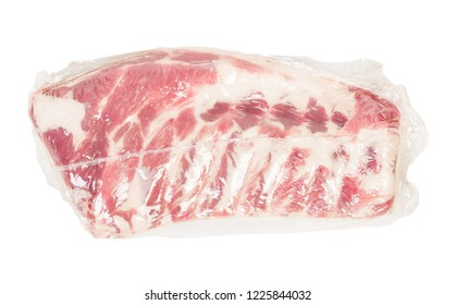Vacuum packed fresh pork ribs meat isolated on white