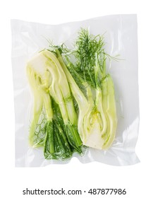 Vacuum sealed fresh fennel for sous vide cooking cutout on white