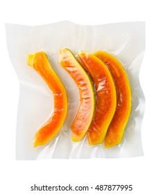 Vacuum sealed fresh papaya for sous vide cooking on white background cutout on white