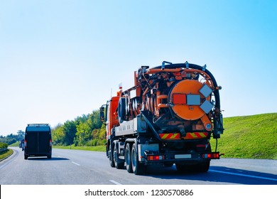 Vacuum waste truck on the highway road in Slovenia.