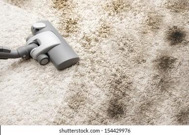 Vacuuming very dirty carpet in house