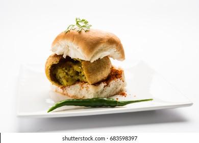 Vada Pav, alternatively spelt Vada Paav or Wada Pav is a vegetarian roadside fast food dish from Maharashtra. Selective focus
