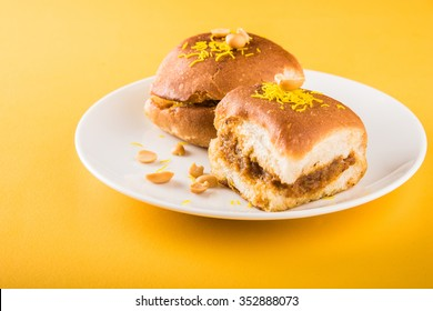 Vada Pav OR Wada Pao is Indian style Desi Burger, is a roadside fast food dish from Maharashtra. Selective focus
