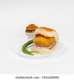 vadapav and chutney in a dish on white background