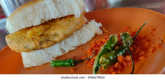 VADA-PAV is one of the famous food in Maharashtra the taste of VADA-PAV with green chill and red chutni was delicious - Shutterstock ID 1946679814