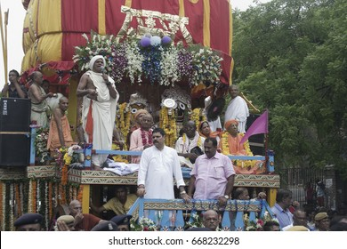 VADODARA, GUJARAT / INDIA - JUNE 25, 2017 : CLOSE UP VIEW OF THE LORD JAGANNATH SURROUNDED BY THE PRIESTS AND DEVOTEES ON THE CHARIOT DURING THE FESTIVAL IN VADODARA, INDIA.